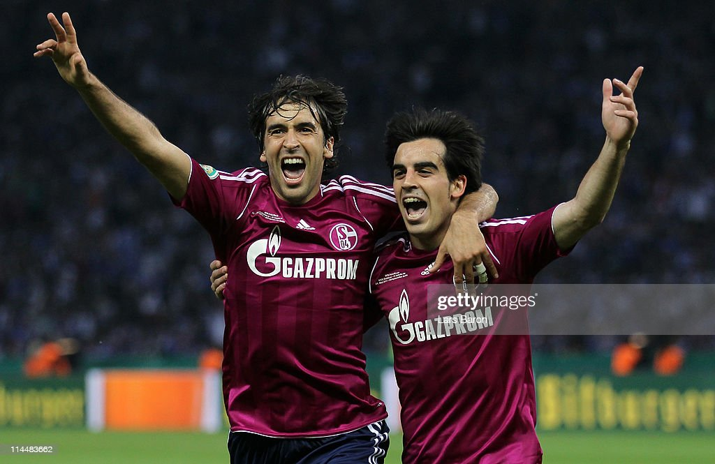 Jose Manuel Jurado of Schalke celebrates with team mate Raul Gonzalez after scoring his teams fourth goal during the DFB Cup final match between MSV...