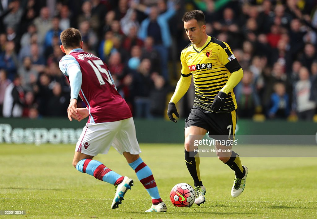 Jose Manuel Jurado of Watford and Ashley Westwood of Aston Villa compete for the ball during the Barclays Premier League match between Watford and Aston Villa at Vicarage Road on April 30, 2016 in Watford, England.