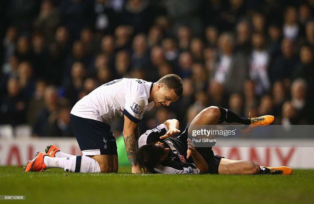 <a gi-track='captionPersonalityLinkClicked' href=/galleries/search?phrase=Jose+Manuel+Jurado&family=editorial&specificpeople=4070797 ng-click='$event.stopPropagation()'>Jose Manuel Jurado</a> of Watford lies injured after colliding with <a gi-track='captionPersonalityLinkClicked' href=/galleries/search?phrase=Kieran+Trippier&family=editorial&specificpeople=6335851 ng-click='$event.stopPropagation()'>Kieran Trippier</a> of Tottenham Hotspur during the Barclays Premier League match between Tottenham Hotspur and Watford at White Hart Lane on February 6, 2016 in London, England.