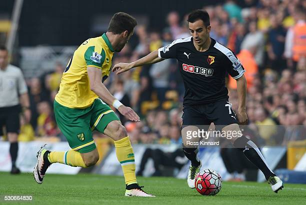 Jose Manuel Jurado of Watford takes on Ivo Pinto of Norwich City during the Barclays Premier League match between Norwich City and Watford at Carrow...