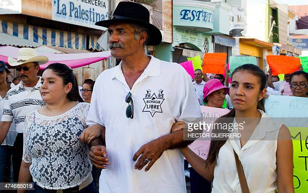 Jose Manuel Mireles a leader of the SelfProtection Police walks accompanied by his daughters Jatziri and Yadira Mireles in Tepalcatepec community...