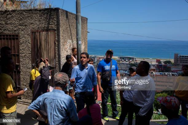 Jose Manuel Olivares opposition coalition governor candidate for Vargas State center left speaks with residents while campaigning in La Guaira...