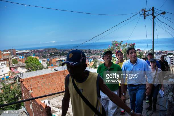 Jose Manuel Olivares opposition coalition governor candidate for Vargas State right walks with volunteers while campaigning in La Guaira Venezuela on...