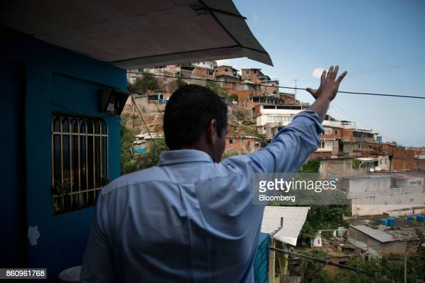 Jose Manuel Olivares opposition coalition governor candidate for Vargas State waves to supporters while campaigning in La Guaira Venezuela on Friday...