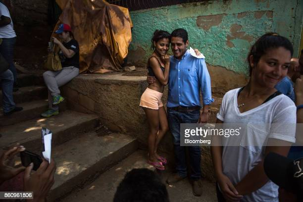 Jose Manuel Olivares opposition coalition governor candidate for Vargas State center stands for a photograph with a supporter in La Guaira Venezuela...