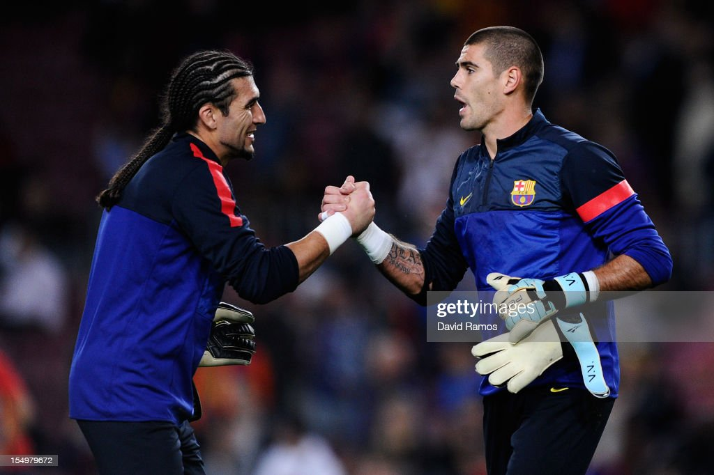 <a gi-track='captionPersonalityLinkClicked' href=/galleries/search?phrase=Jose+Manuel+Pinto&family=editorial&specificpeople=708358 ng-click='$event.stopPropagation()'>Jose Manuel Pinto</a> of FC Barcelona (L) and his teammate <a gi-track='captionPersonalityLinkClicked' href=/galleries/search?phrase=Victor+Valdes&family=editorial&specificpeople=552392 ng-click='$event.stopPropagation()'>Victor Valdes</a> shake hands during the warm up prior to the UEFA Champions League Group G match between FC Barcelona and Celtic FC at the Camp Nou Stadium on October 23, 2012 in Barcelona, Spain. FC Barcelona won 2-1.