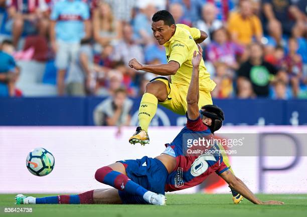 Jose Manuel Rodriguez of Levante competes for the ball with Carlos Bacca of Villarreal during the La Liga match between Levante and Villarreal at...