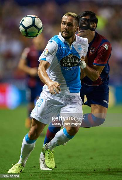 Jose Manuel Rodriguez of Levante competes for the ball with Florin Andone of Deportivo during the La Liga match between Levante and Deportivo La...