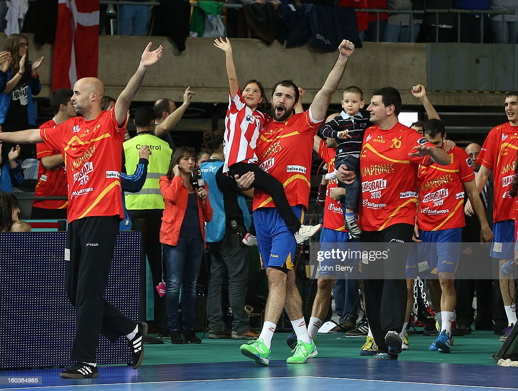 Jose Manuel Sierra, Joan Canellas, Arpad Sterbik of Spain celebrate their victory and their gold medal after the Men's Handball World Championship 2013 final match between Spain and Denmark at Palau Sant Jordi on January 27, 2013 in Barcelona, Spain.