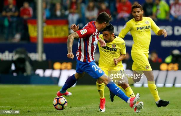 Jose María Gimenez of Atletico Madrid Jaume Costaof Villarreal and Jonathan Dos Santos of Villarreal battle for the ball during the La Liga match...