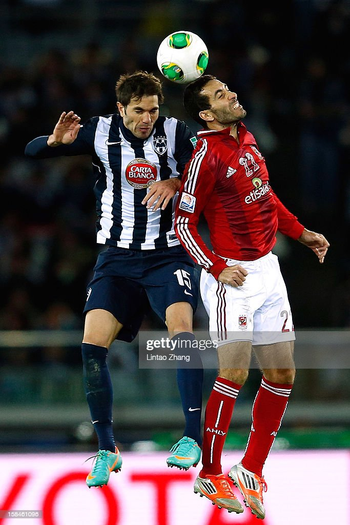 Jose Maria Basanta of Monterrey and Mohamed Aboutrika of AlAhly SC jump for a header during the FIFA Club World Cup 3rd Place Match between AlAhly SC...