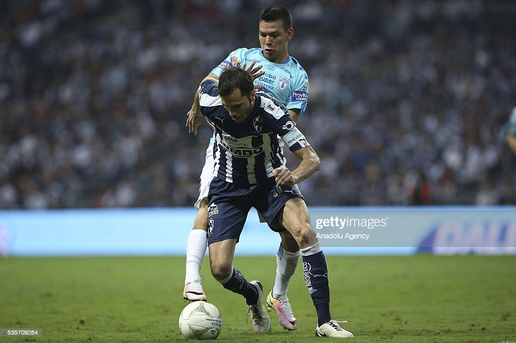 Jose Maria Basanta (front) of Monterrey in action against Hirving Lozano of Pachuca during the Final second leg match of the Clausura 2016 Liga MX between Monterrey and Pachuca, at BBVA Bancomer Stadium, in Monterrey, Mexico on May 29, 2016.