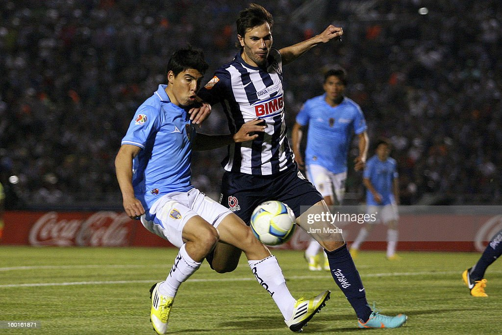 Jose Maria Basanta (R) of Monterrey struggles for the ball with Angel Mendoza (L) of San Luis during a match between Monterrey v San Luis as part of the Clausura 2013 Liga MX at Tecnologico Stadium on January 26, 2013 in Monterrey, Mexico.