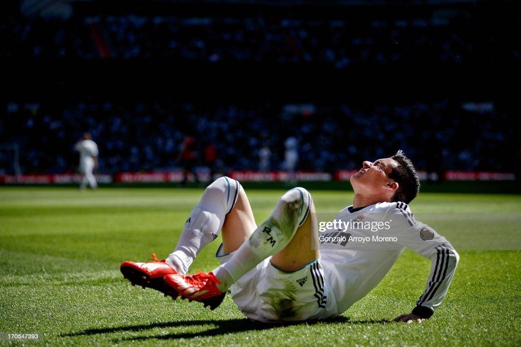 Jose Maria Callejon of Real Madrid CF grimaces in pain after a foul during the La Liga match between Real Madrid CF and CA Osasuna at Estadio...