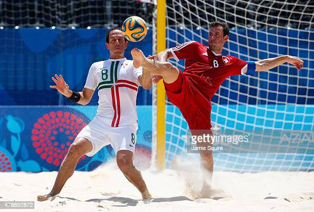 Jose Maria Fonseca of Portugal and Moritz Jaeggy of Switzerland battle for the ball during the Men's Beach Soccer bronze medal match between...