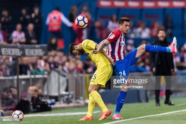 Jose Maria Gimenez de Vargas of Atletico de Madrid fights for the ball with Mateo Pablo Musacchio of Villarreal CF during the La Liga match between...
