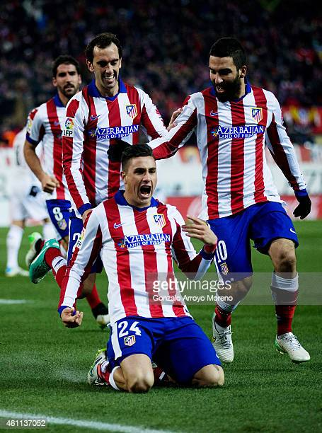 Jose Maria Gimenez of Atletico de Madrid celebrates scoring their second goal with teammates during the Copa del Rey Round of 16 first leg match...