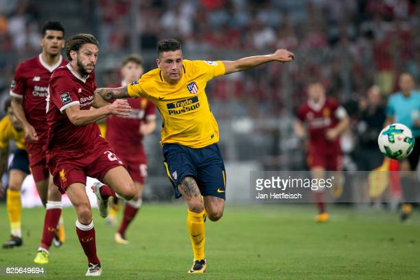 Jose Maria Gimenez of Atletico Madrid and Adam Lallana of FC Liverpool fight for the ball during the Audi Cup 2017 match between Liverpool FC and...