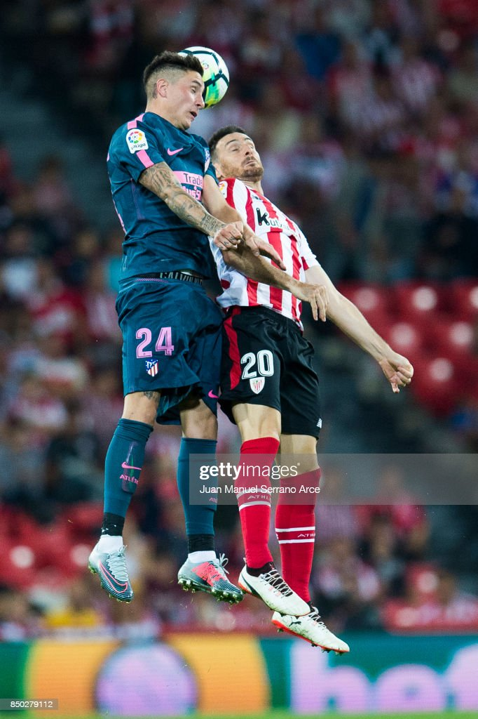 Jose Maria Gimenez of Atletico Madrid competes for the ball with Aritz Aduriz of Athletic Club during the La Liga match between Athletic Club and Atletico Madrid at San Mames Stadium on September 20, 2017 in Bilbao, Spain.
