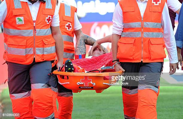 Jose Maria Gimenez of Atletico Madrid is taken off injured during the La Liga match between Atletico Madrid and Deportivo La Coruna at Vincente...