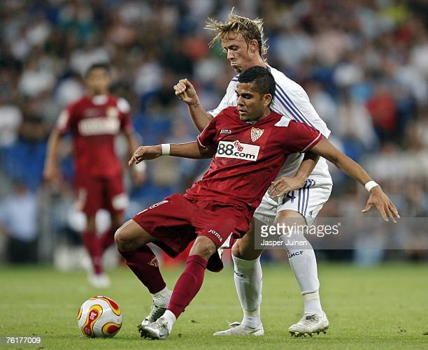 Jose Maria Gutierrez right of Real Madrid duels for the ball with Daniel Alves of Sevilla during the Spanish Super Cup second leg match between Real...
