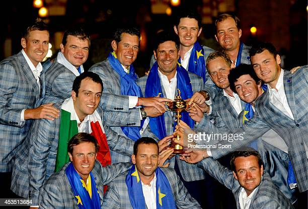 Jose Maria Olazabal and the victorious European Team celebrate with the trophy after their famous comeback in the Singles Matches for The 39th Ryder...