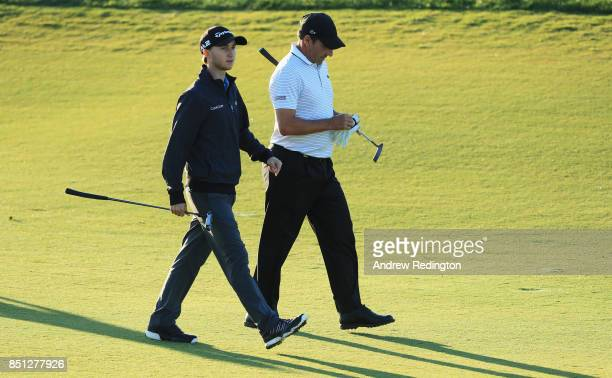 Jose Maria Olazabal of Spain and Austin Connelly of Canada walk on the 10th hole during day two of the Portugal Masters at Dom Pedro Victoria Golf...
