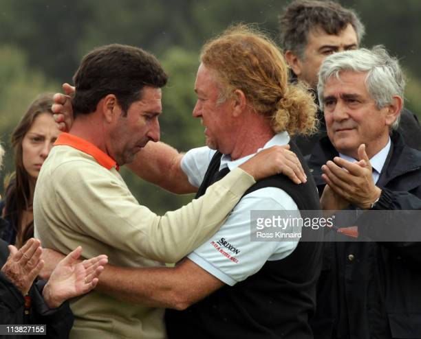 Jose Maria Olazabal of Spain and Miguel Angel Jimenez of Spain after the minute silence held in memory of Seve Ballesteros during the third round of...