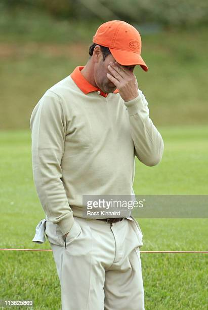 Jose Maria Olazabal of Spain makes his way to the first tee following news of the death of Seve Ballesteros during the third round of the Open de...