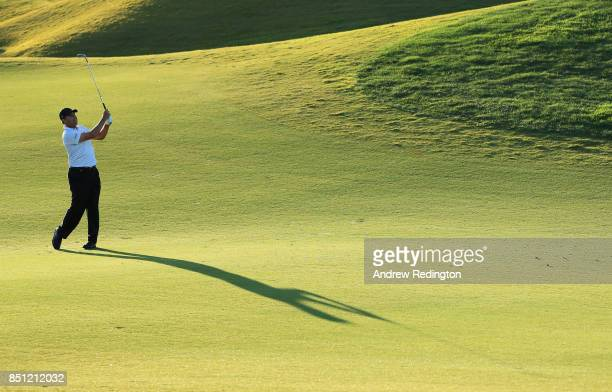 Jose Maria Olazabal of Spain plays his second shot on the 10th hole during day two of the Portugal Masters at Dom Pedro Victoria Golf Club on...