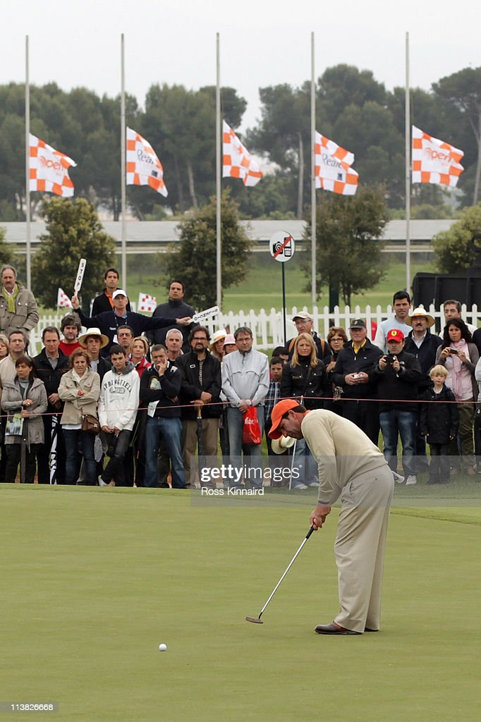 Jose Maria Olazabal of Spain putts on the 18th green with the flags flying at half mast following news of the death of Seve Ballesteros during the...