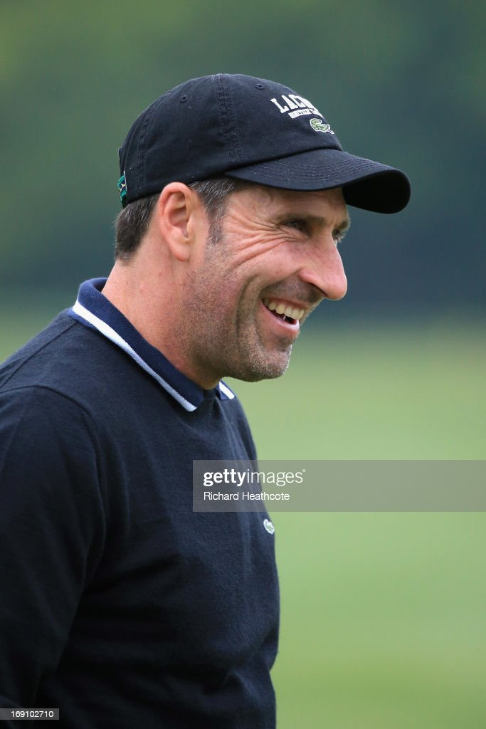 Jose Maria Olazabal of Spain smiles while on the driving range during a practise day for the BMW PGA Championships at Wentworth on May 20, 2013 in Virginia Water, England.