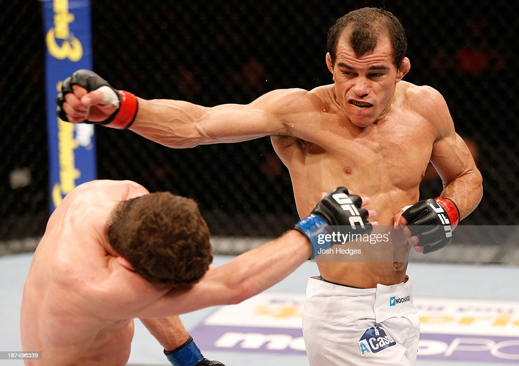 Jose Maria throws a spinning back fist at Dustin Ortiz in their flyweight bout during the UFC event at Arena Goiania on November 9, 2013 in Goiania, Brazil.