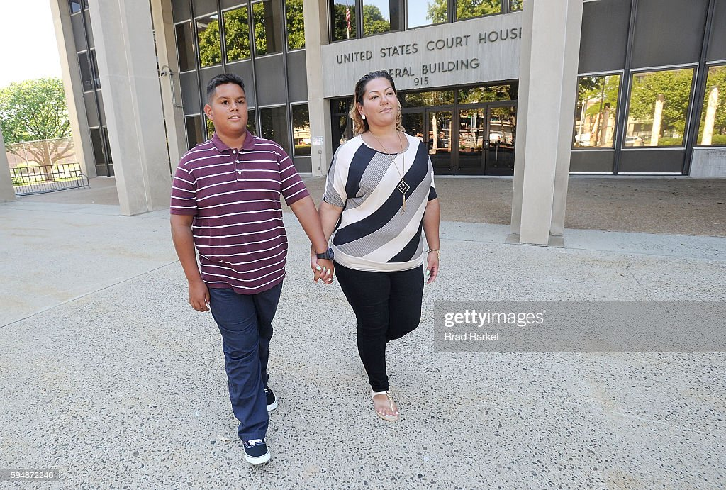 Jose Martinez and his mother Jessica Martinez lead plaintiff in Martinez v Malloy pose for a photo outside the US District Court for the District of...