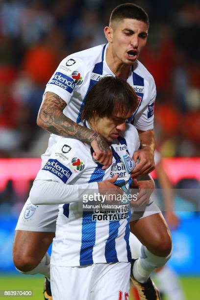 Jose Martinez and Victor Guzman of Pachuca celebrate the first goal of their team during the 10th round match between Pachuca and Toluca as part of...