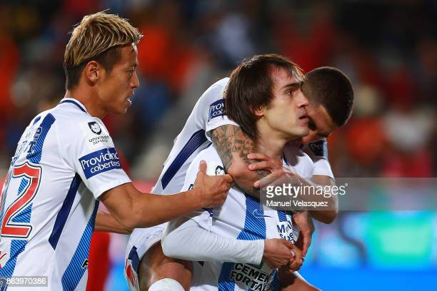 Jose Martinez of Pachuca celebrates with teammates after scoring the first goal of his team during the 10th round match between Pachuca and Toluca as...