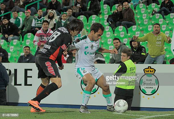 Jose Martinez of Pachuca fights for the ball with Adrian Aldrete of Santos Laguna during the 10th round match between Santos Laguna and Pachuca as...