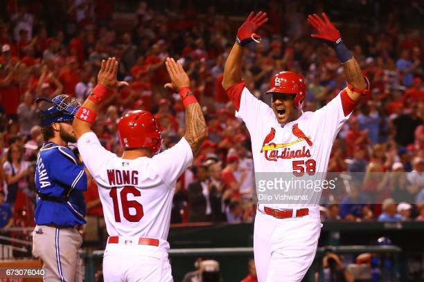 Jose Martinez of the St Louis Cardinals celebrates after hitting a solo home run his first career home run against the Toronto Blue Jays in the...