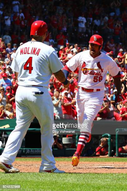 Jose Martinez of the St Louis Cardinals celebrates after hitting a tworun home run against the Arizona Diamondbacks in the fourth inning at Busch...