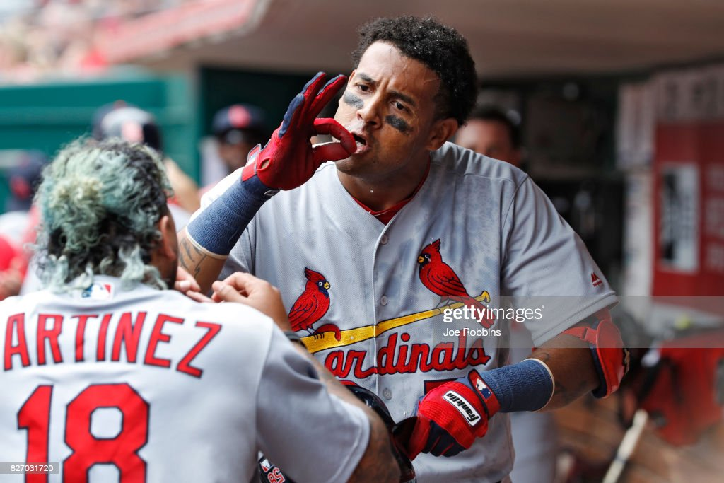 Jose Martinez #58 of the St. Louis Cardinals celebrates with Carlos Martinez #18 in the dugout after hitting a grand slam home run in the fourth inning of a game against the Cincinnati Reds at Great American Ball Park on August 6, 2017 in Cincinnati, Ohio.