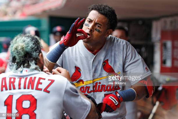 Jose Martinez of the St Louis Cardinals celebrates with Carlos Martinez in the dugout after hitting a grand slam home run in the fourth inning of a...