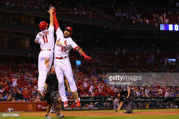 Jose Martinez of the St Louis Cardinals celebrates with Paul DeJong after hitting a tworun home run against the Milwaukee Brewers in the ninth inning...