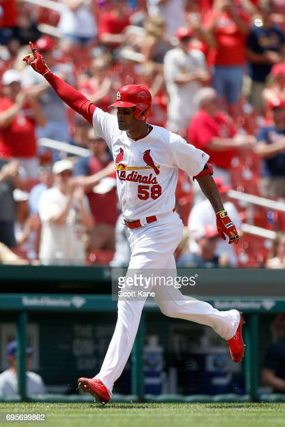 Jose Martinez of the St Louis Cardinals gestures as he runs the bases after hitting a solo home run during the fifth inning against the Milwaukee...