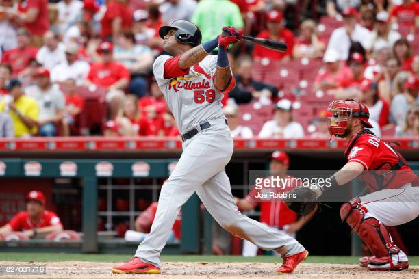 Jose Martinez of the St Louis Cardinals hits a grand slam home run in the fourth inning of a game against the Cincinnati Reds at Great American Ball...