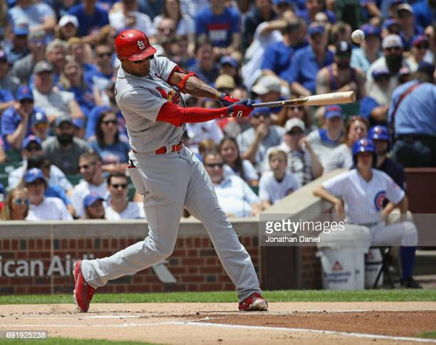 Jose Martinez of the St Louis Cardinals hits a two run single in the 1st inning against the Chicago Cubs at Wrigley Field on June 3 2017 in Chicago...