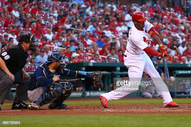 Jose Martinez of the St Louis Cardinals hits an RBI single against the Milwaukee Brewers in the first inning at Busch Stadium on June 13 2017 in St...