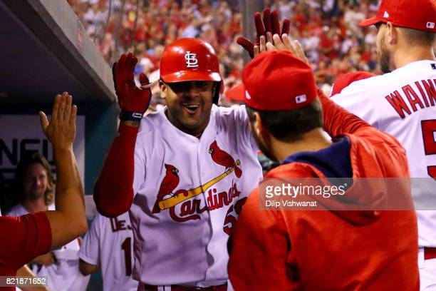 Jose Martinez of the St Louis Cardinals is congratulated after hitting a solo home run against the Colorado Rockies in the seventh inning at Busch...
