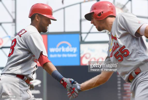 Jose Martinez of the St Louis Cardinals is congratulated by Stephen Piscotty after Martinez hit a solo home against the San Francisco Giants in the...