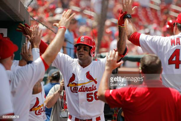 Jose Martinez of the St Louis Cardinals is congratulated by teammates after hitting a solo home run during the fifth inning against the Milwaukee...