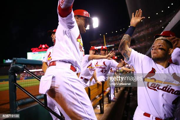 Jose Martinez of the St Louis Cardinals is congratulated by Yadier Molina of the St Louis Cardinals after hitting a home run against the Kansas City...
